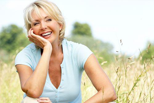 women smiling in a field